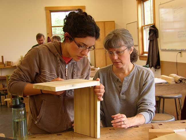 Workshop Assistant Lisa Kaliczak with a student