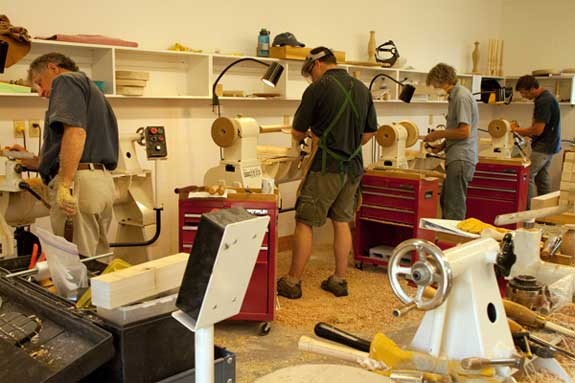 Students at work on the lathe; photo by Emily Lessner