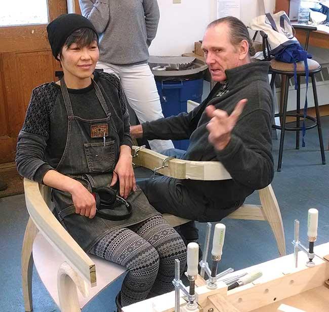Artist David Upfill-Brown and Studio Fellow Yuri Kobayashi seated in a mockup of David's Kissing Chair during a bi-weekly critique, 2014