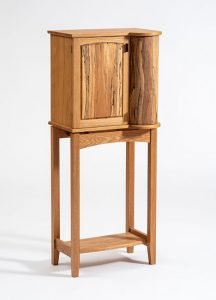 """Sayer G. Houseal   Rockport, ME. Drinks Cabinet, 2019. White oak, spalted sycamore, walnut pulls, osmo oil finish. $2,800. 48"""" x 19"""" x 12""""."""