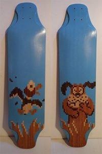 """Sayer Houseal   Antarctica. Duck Hunt Longboards, 2020. Maple veneer board, assorted veneer image, paint, wax. $550 each. 36"""" x 10""""."""
