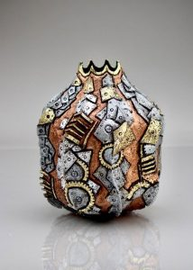"""George Partal, MD   Bangor, ME. Fortified Armor, 2020. Locally harvested oak, pyrography, Pebeo guilding waxes, acrylic paint, gold and silver foil. $499. 11"""" x 9"""" dia."""