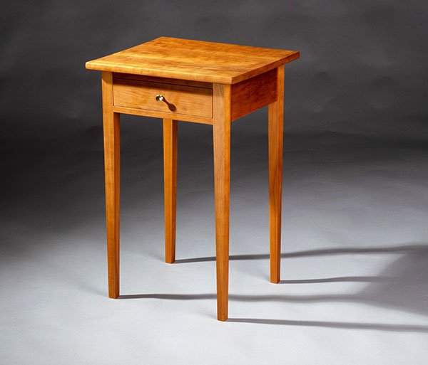 Students learn to design and build tables with tapered legs and drawers.
