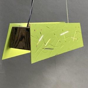 "Christopher Poehlmann | Philadelphia, PA. Rough Hewn Linear Pendant, 2021. Carved and painted aluminum, acrylic, LED, oak. 6"" x 6"" x 23.5"". $650."