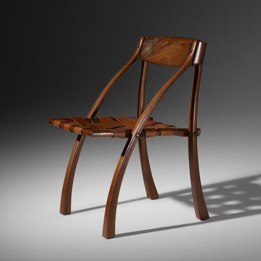 "Arthur Espenet Carpenter 1920 - 2006. Wishbone Chair, 1970. Walnut, leather. 31"" x 22"" x 22"". Lent by Glenn Adamson"