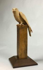 "Chris Pye Hereford, UK. Merlin, 2021. Bird & Post: Lacewood (London Plane); Base: European oak. 21"" x 10"" x 6.5"". $6,000."