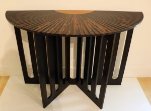 """Alan Peters 1933 - 2009. Fluted Fan Table, 1994. Indian ebony. 33.25"""" x 48"""" x 20"""". Collection of Diane and Marc Grainer."""